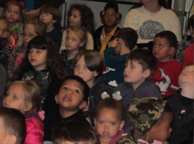 "Nothing says ""Christmas"" more than the expressions on children's faces. These Head Start students are shown listening to a Friends of the Library storytime during a 4-H Museum open house program on Dec. 6. {Photos by Raymond L. Daye}"